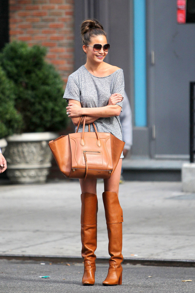 Chrissy+Teigen+wearing+knee+length+brown+leather+SUDOCoy3gJNx